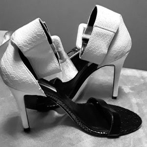 Guess stiletto heels size 8M. Black and white